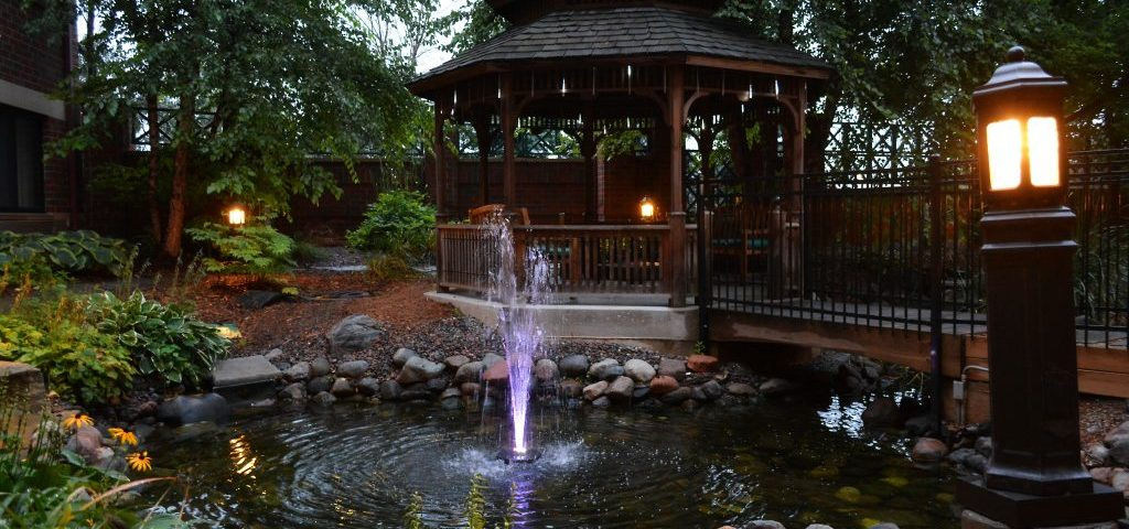Beautiful night time lights at gazebo at Courtyard By Marriott in Roseville MN