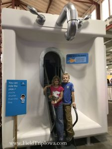 Kids stand in front of sink slide at Minnesota State Fair