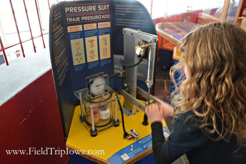 Child pulls on lever at Bluedorn Science Imaginarium in Waterloo Iowa.