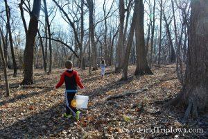 Children walking in woods at Hartmand Reserve Nature Center in Cedar Falls Iowa.