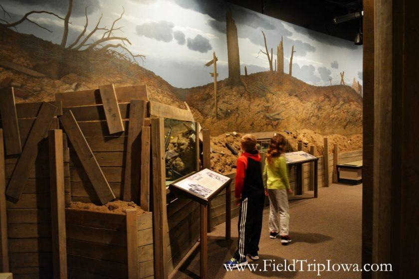 Children look at displays at Sullivan Brothers Iowa Veterans Museum Waterloo