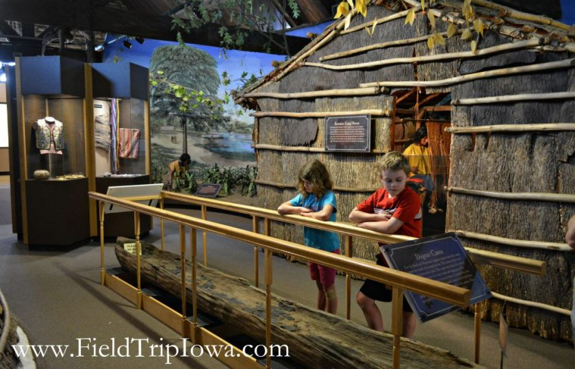 Children view dugout conoe at John Hauberg Indian Museum