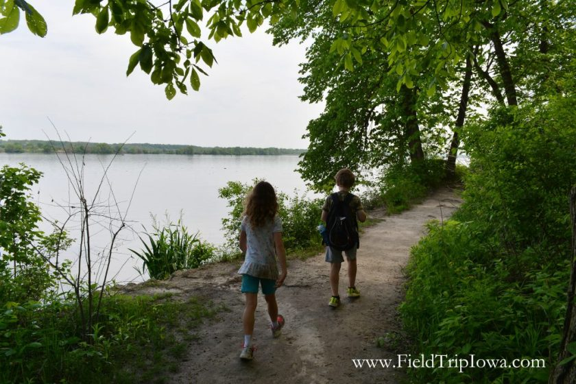 Kids walking along path neat river in Starved Rock State Park, IL