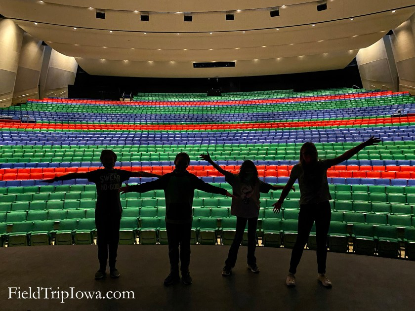 Children's silhouettes against the backdrop of the seating at the Des Moines Civic Center