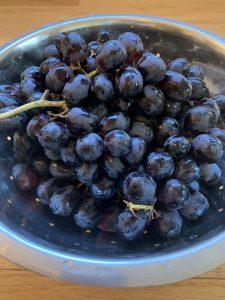 Bowl of purple grapes