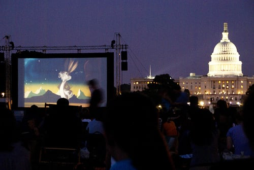 Screen on the Green offers views of the Capitol Building while watching movies on the National Mall.  (Photo: Riacale/Flickr)