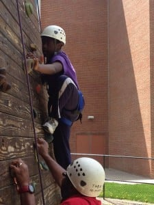 Damani, who has Down syndrome, is a typical kid in many respects. Here, he rock climbs with his father.