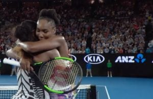 Venus and Serena Williams hug after the singles championship at the Australian Open. (Screen shot from Tennis Australia video)