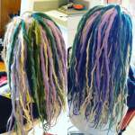 About 20 synth dreads accent this head full of natural platinum dreadies