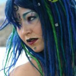 blue and green synth dread extensions on Meggie