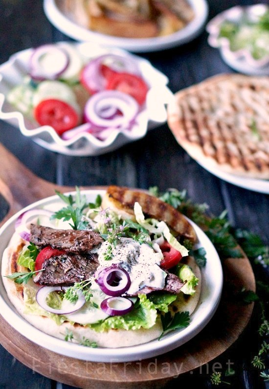 Seasoned right, inexpensive cuts of beef like top or bottom round steaks, aka London Broil, can make an exceptionally satisfying meal, perfect for feeding a crowd without breaking the bank | FiestaFriday.net #steak #londonbroil #lebanese #middleeastern #gyro