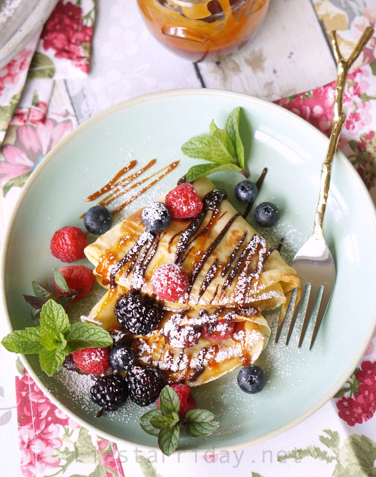Chocolate Caramel Cream Cheese Crepes   FiestaFriday.net   Crepes are not at all hard to make, despite its French name, and they can be made sweet or savory. In this recipe, filled with cream cheese and served with berries and chocolate as well as caramel sauce, they make the perfect Mother's Day breakfast or dessert! #crepes #chocolate #caramel #creamcheese #dessert #snack #sweetsnack #easydessert