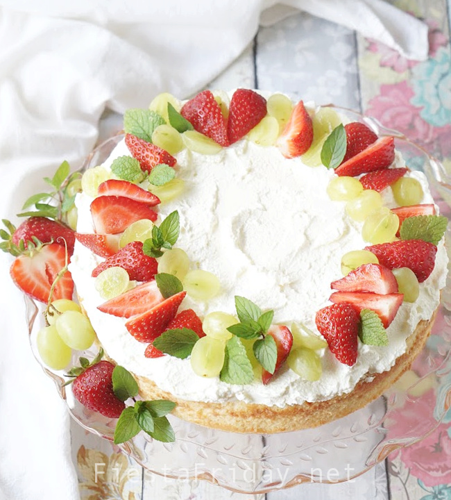 Tres Leches Cake topped with vanilla whipped cream and decorated simply with fresh strawberries and grapes. It's the lightest and freshest Tres Leches Cake there is! #tresleches #treslechescake #pasteltresleches #3milkcake #mexicancuisine #mexicanfood #dessert #cake #freshfruits #cincodemayo