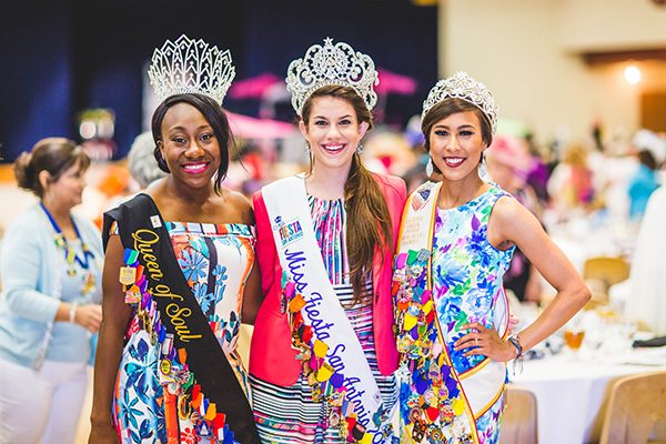 Miss Fiesta is one of nine considered Official Fiesta Royalty. Here Miss Fiesta (center) poses with Reina de la Feria de las Flores (right) and Queen of Soul (left).