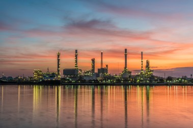 Oil refinery with sunrise