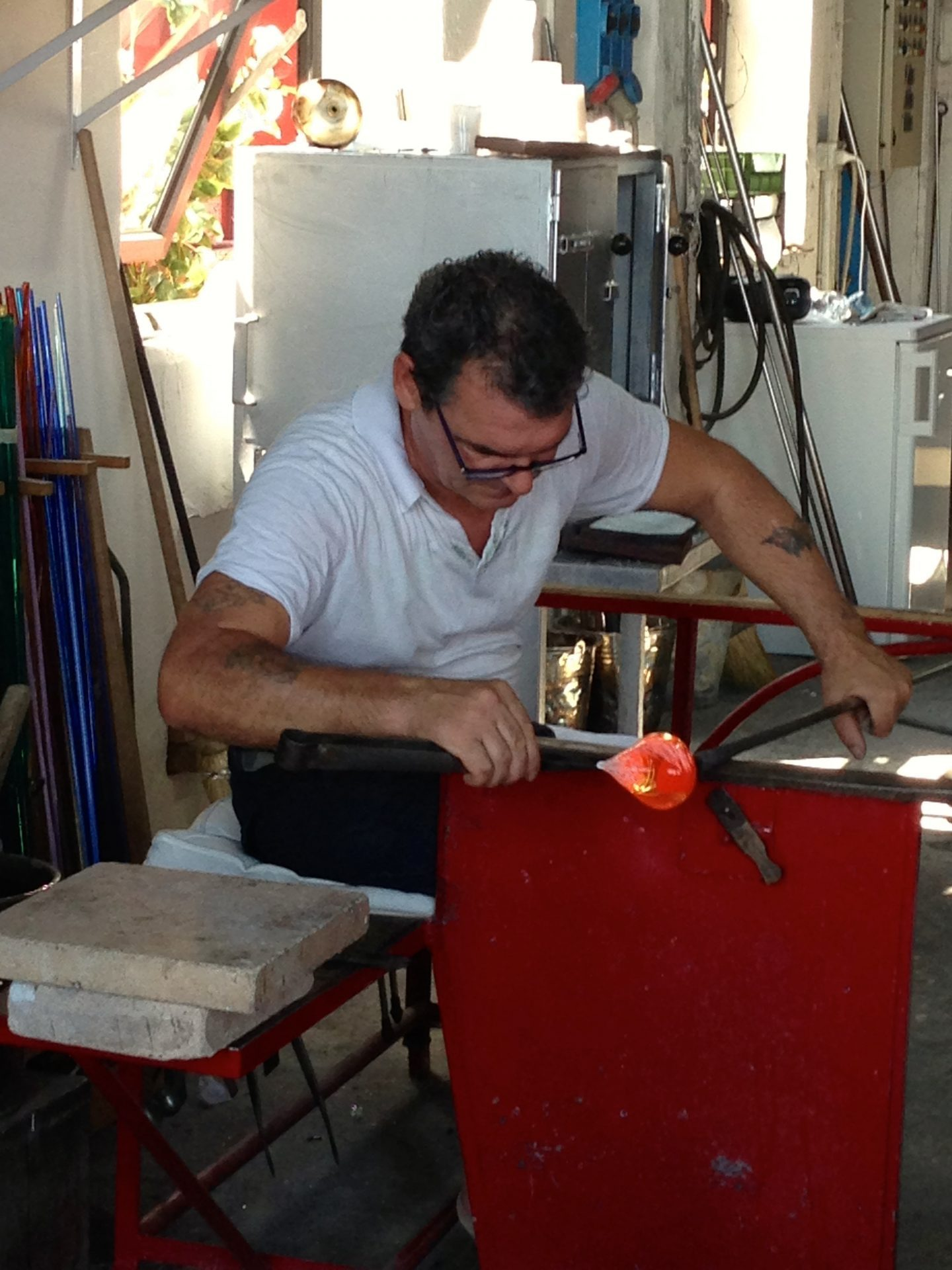Watching the glass blowing in Murano,.