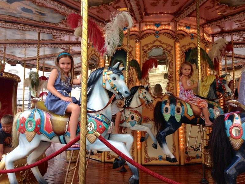 Taking a spin on the carousel in Florence.