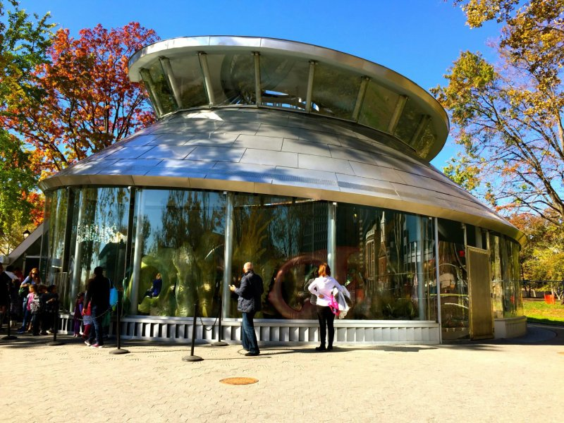 Outside of the building of the Seaglass carousel in Battery Park, New York City.