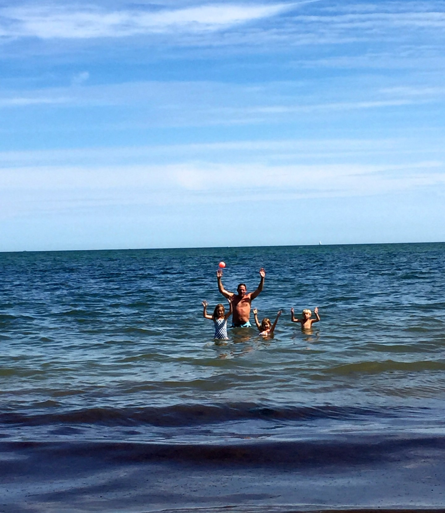 Uncle Whit swimming with the kids in Osterville, MA.