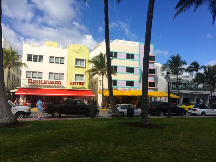 Viewing the art deco buildings in South Beach Miami from the boardwalk.