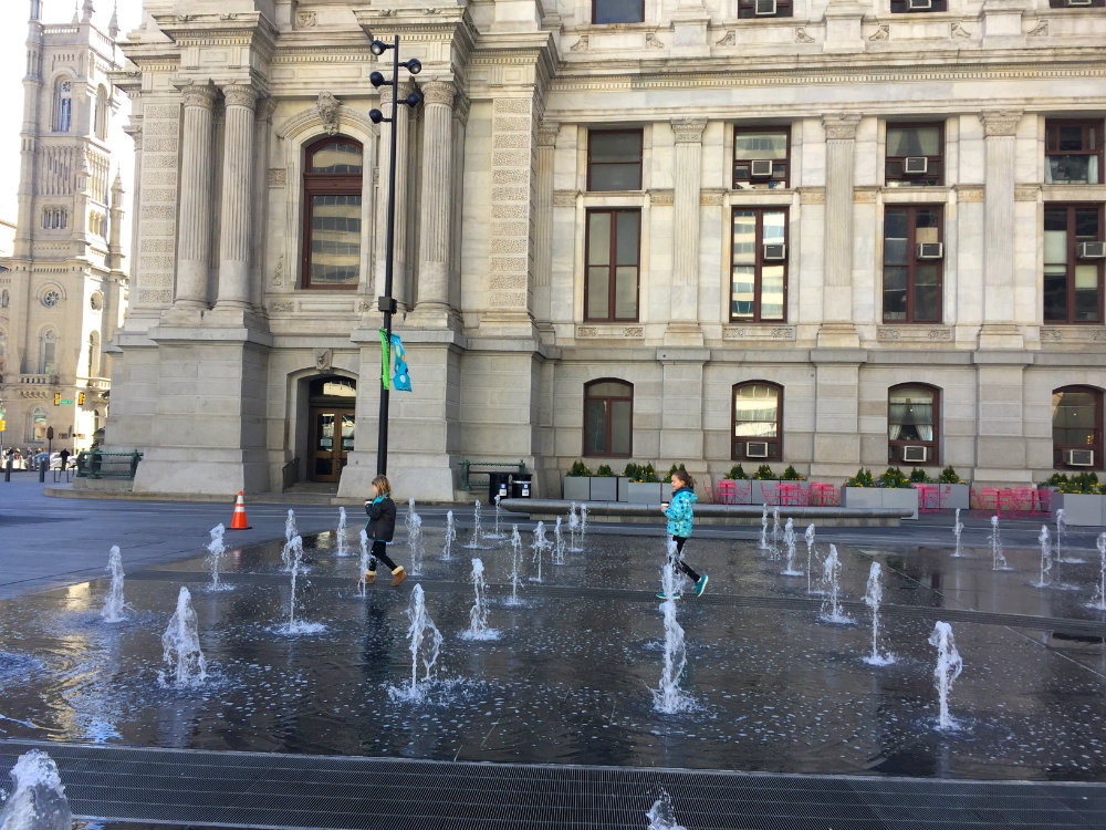 Things to do with kids in Philadelphia, exploring the fountain at City Hall in Philadelphia.