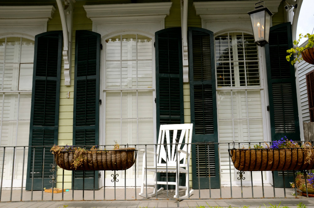 Admiring the porches with rocking chairs in the Garden District of New Orleans.