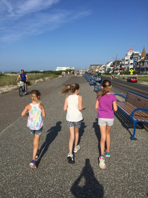 Girls running along the promenade in Cape May, New Jersey.
