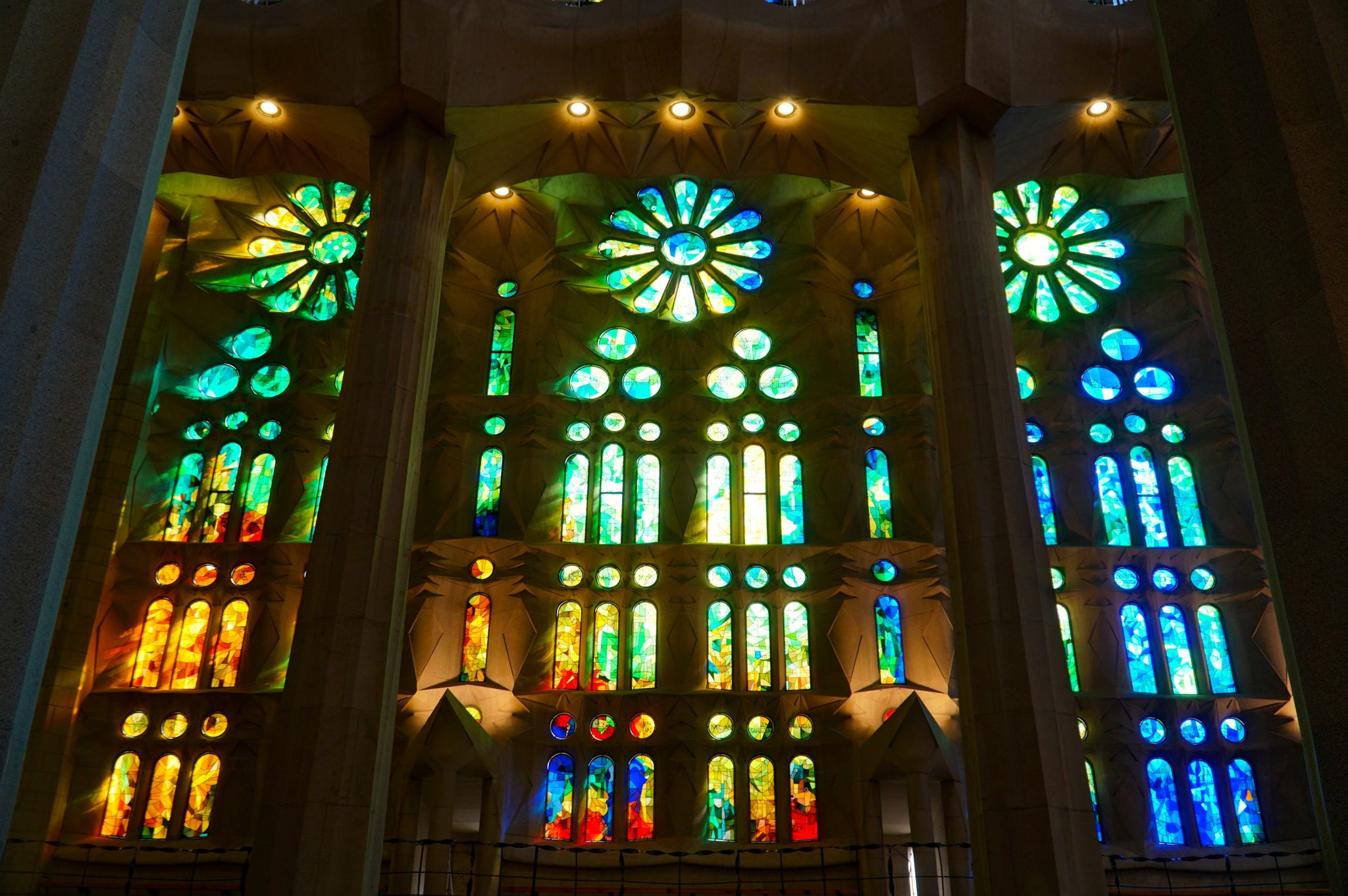 Looking at the stained-glass windows in the Sagrada Familia by Gaudi.