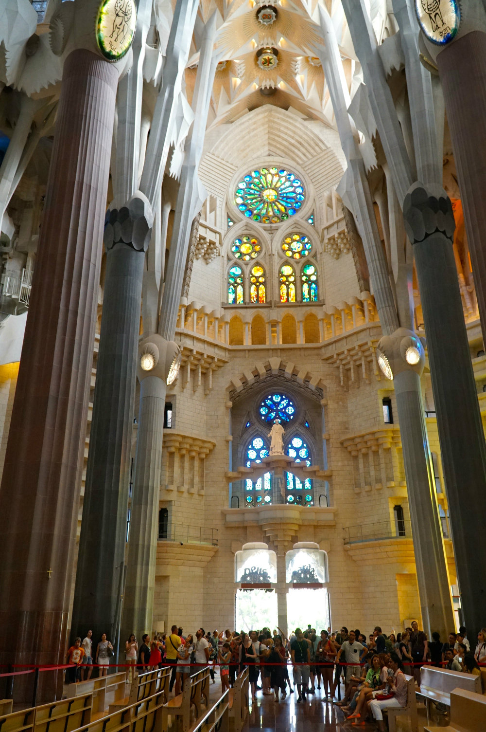 Walking inside of the Sagrada Familia by Gaudi in Barcelona.