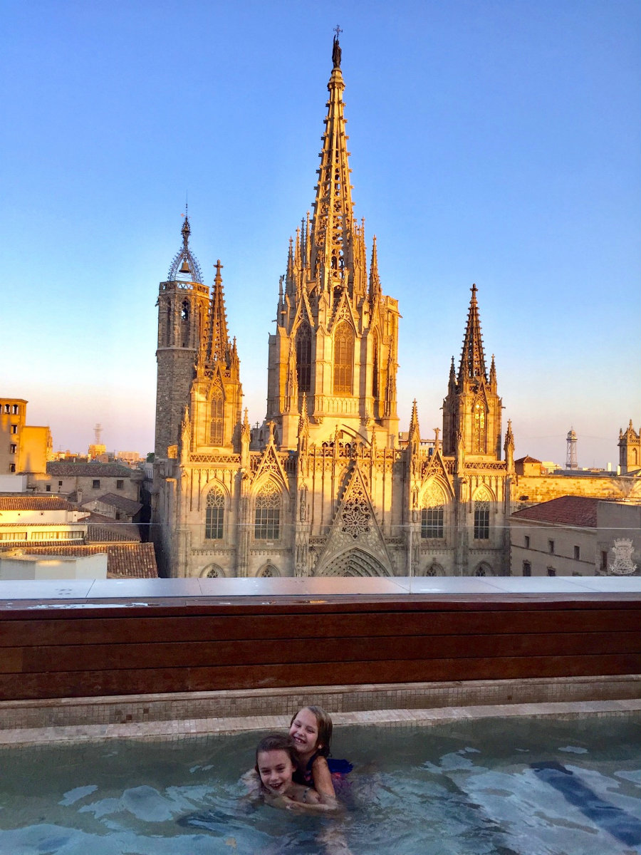 Swimming at our hotel rooftop next to the Barcelona cathedral.