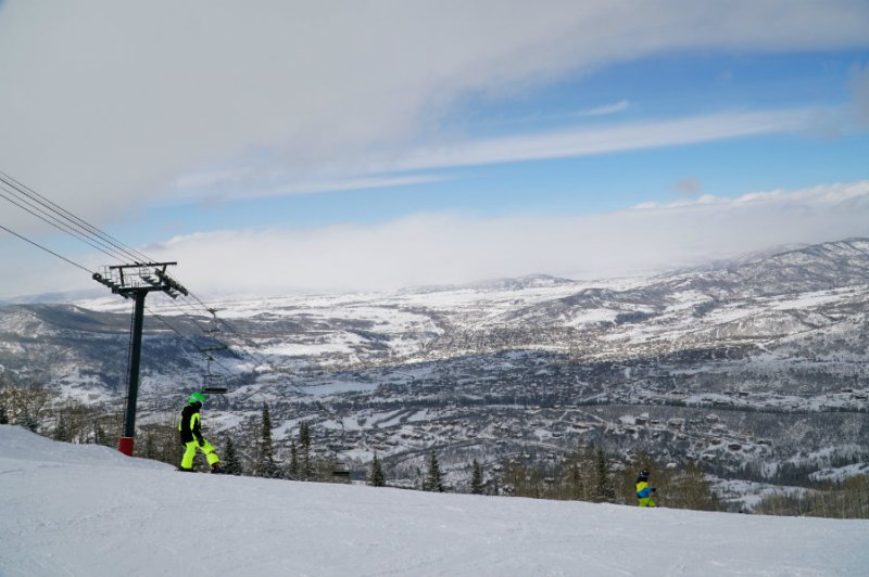 Skiing down the mountain at Steamboat Springs ski resort