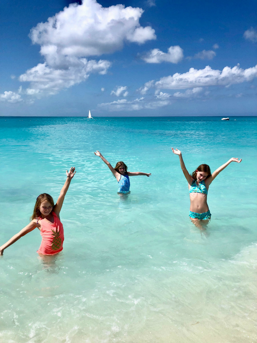 Girls swimming in Grace Bay at Turks and Caicos