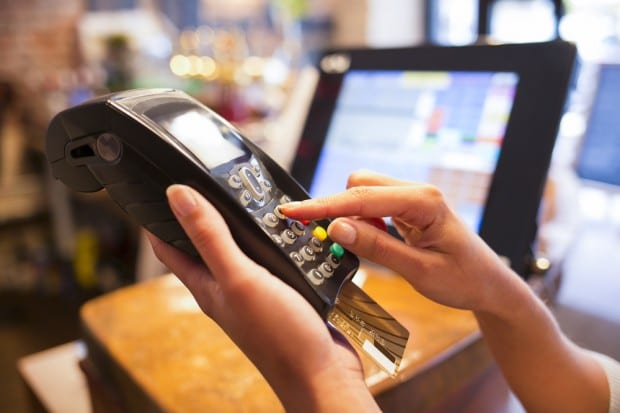 woman-credit-card-terminal