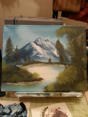 My youngest painting along with Bob Ross!