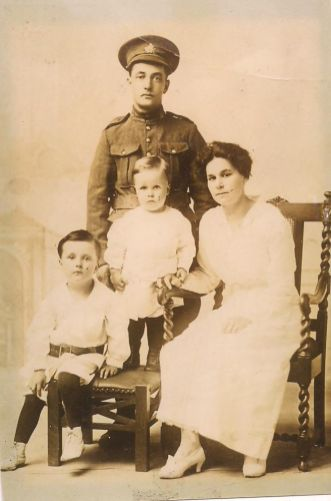 Joseph James Foster, Mary Alice Foster, Gordon Whitfield Foster (seated), Earl Edwin Foster (standing on chair).