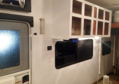 Toy Hauler Travel Trailer Renovations - Primer Coats on Cabinets and Walls