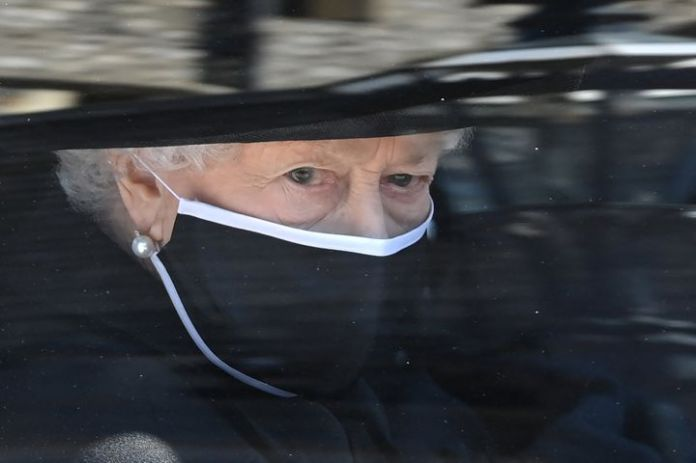Britain's Queen Elizabeth II arrives in the Royal Bentley at the funeral for her husband, the Duke of Edinburgh, at St George
