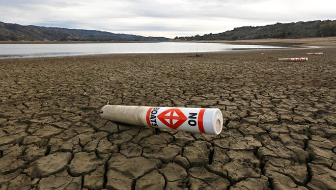 A warning buoy sits on the dry, cracked bed of Lake Mendocino near Ukiah, Calif., in February 2014. Droughts in California would probably become more frequent if there were more La Ninas.