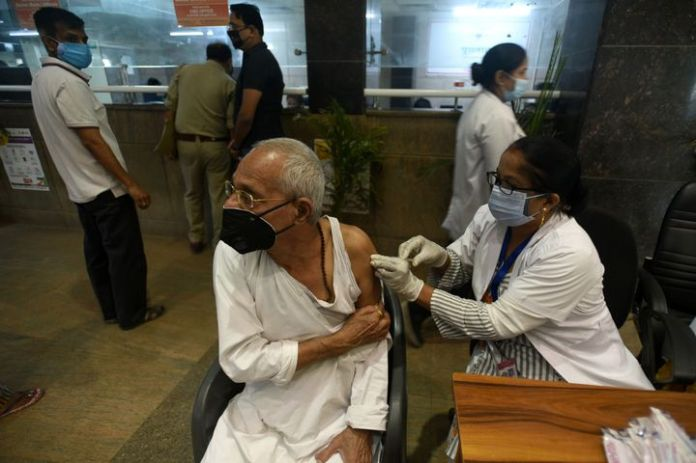 NOIDA, INDIA - APRIL 24: An elderly man gets vaccinated against Covid-19, at a district hospital at sector 30, on April 24, 2