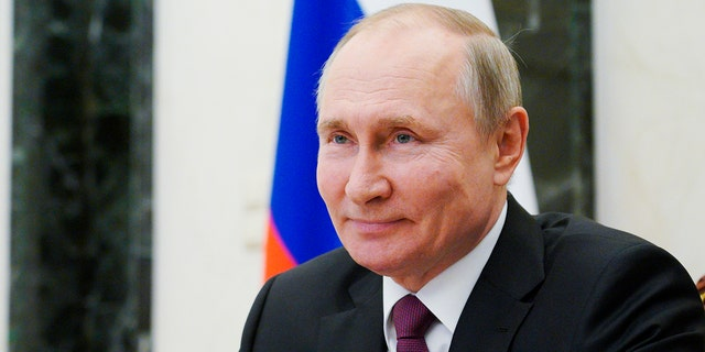 Russian President Vladimir Putin attends a meeting with young award-winning cultural professionals via video conference, at the Kremlin in Moscow, Russia, Thursday, March 25, 2021. (Alexei Druzhinin, Sputnik, Kremlin Pool Photo via AP)