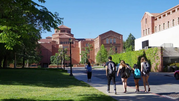 Los Angeles, California, USA - May 2, 2017. The location is University of California, Los Angeles. Large group of students walking about at the University campus.