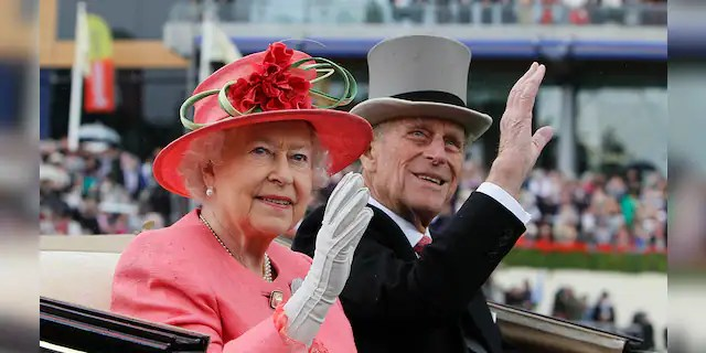 FILE - In this Thursday, June 16, 2011 file photo Britain's Queen Elizabeth II with Prince Philip arrive by horse-drawn carriage in the parade ring on the third day, traditionally known as Ladies Day, of the Royal Ascot horse race meeting at Ascot, England. Prince Philip died at the age of 99 on April 9.