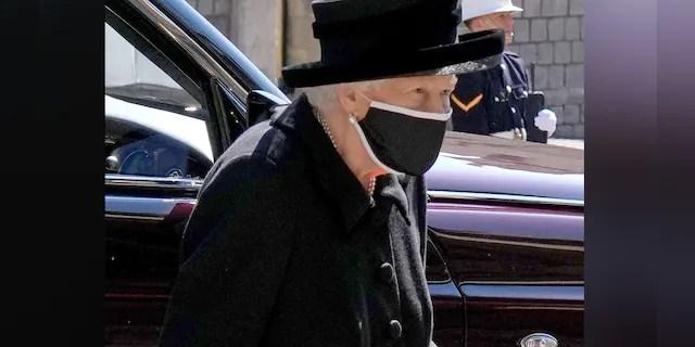 Queen Elizabeth II arrives for the funeral service of Britain's Prince Philip, Duke of Edinburgh inside St George's Chapel in Windsor Castle in Windsor, west of London, on April 17, 2021.