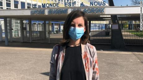 """Colleen Brown teaches English at Eugene Delacroix high school. She says French classrooms have been kept open """"at all costs"""" during much of the coronavirus pandemic."""