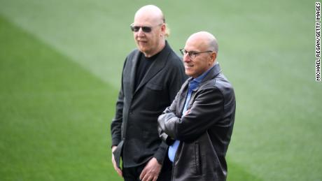 Joel and Avram Glazer looks on as they attend a training session.