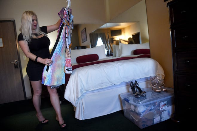 Courtesan Rachel Varga gets her outfits and room ready for clients at the Mustang Ranch Lounge brothel in Storey County on April 30, 2021. Brothels in Nevada are set to reopen on Saturday, May 1. Varga has worked at the Mustang Ranch for 5 years.