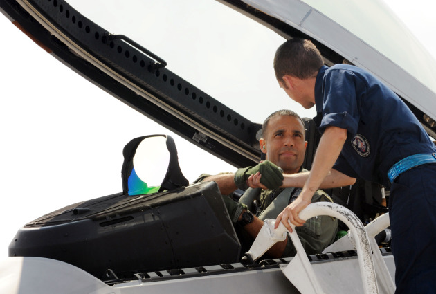 Colonel Adrian Spain, U.S. Air Force Weapons School Commandant, shakes hands with his Dedicated Crew Chief before doing dissimilar air combat training in the F-22A Raptor. (U.S. Air Force photo/Airman 1st Class Jarrod Chavana)