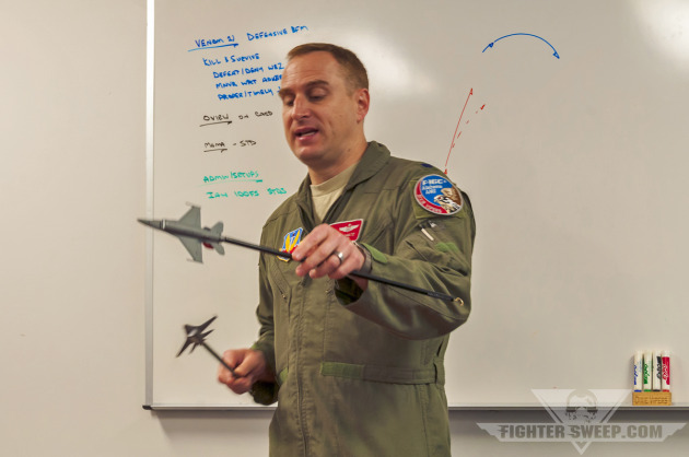 "Lieutenant Colonel Jon ""Habib"" Schultz, F-16C pilot with the 187 FW, Alabama Air National Guard, briefs prior to a BFM sortie."