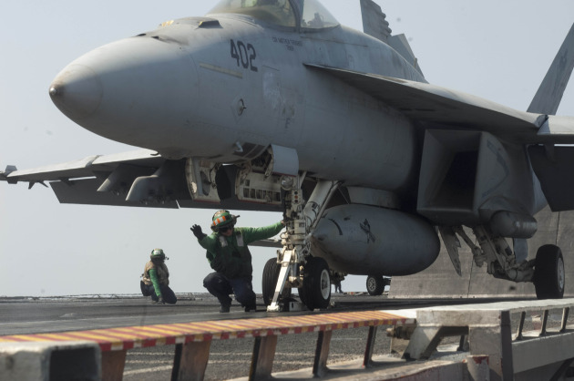 "Aviation Boatswain's Mate (Equipment) 3rd Class Echeverria signals that an F/A-18E Super Hornet, assigned to the ""Gunslingers"" of Strike Fighter Squadron (VFA) 105, is ready for launch on the flight deck of the aircraft carrier USS Harry S. Truman (CVN 75). (U.S. Navy photo by Mass Communication Specialist 2nd Class Lyle H. Wilkie III/Released)"