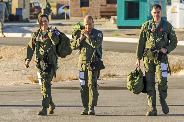 The 187th Operations Group Commander, center, steps to fly with two other pilots during a Green Flag-West sortie.